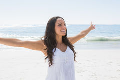 Happy brunette in white sun dress enjoying the sun Royalty Free Stock Photos