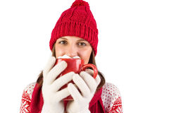 Happy brunette in winter clothes holding mug Stock Photos
