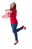 Happy brunette in winter clothes holding presents Stock Photo