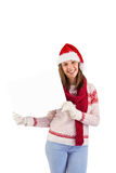 Happy brunette in winter clothes showing card Royalty Free Stock Photos
