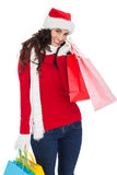 Happy brunette in winter wear holding shopping bags Stock Photo