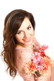 Happy brunette woman with a bouquet of gerberas on white  Stock Photography