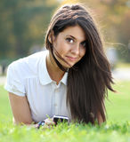 Happy brunette woman calling by phone Stock Image