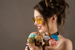 Happy brunette woman with colorful makeup with ice cream Royalty Free Stock Photography