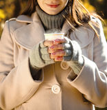 Happy brunette woman drinking coffee outdoors Royalty Free Stock Photography