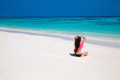 Happy brunette woman enjoying on exotic beach in summer by tropi Royalty Free Stock Photos