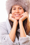 Happy brunette woman in a fur hat. Happy young brunette woman in a fur hat Royalty Free Stock Photos