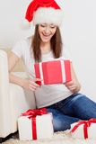Happy brunette woman holding gift box Royalty Free Stock Photography