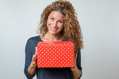 Happy brunette Woman Holding Red Gift Box Stock Images