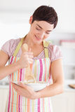 Happy brunette woman preparing a cake Stock Image