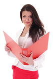 Happy brunette woman with red folder Stock Photo