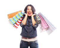 Happy brunette woman with shopping bags. Over white background Stock Photo
