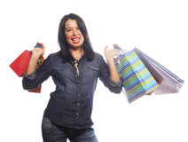 Happy brunette woman with shopping bags. Over white background Royalty Free Stock Images