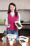 Happy brunette woman with  sprouts Stock Images