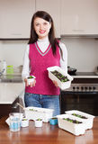 Happy brunette woman with  sprouts Stock Photo