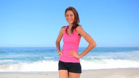 Happy brunette woman standing in front of the sea Royalty Free Stock Images