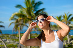 Happy brunette woman on tropical caribbean travel Stock Image