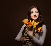 Happy brunette  woman with tulips Stock Images