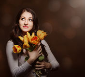 Happy brunette  woman with tulips Stock Photography