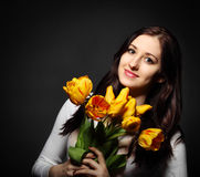 Happy brunette  woman with tulips Stock Photo