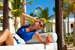 Happy brunette woman on vacation Stock Images