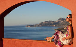 Happy brunette woman on vacation in Sicily stock photography