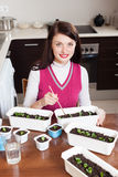 Happy brunette woman working with various seedlings Stock Photography