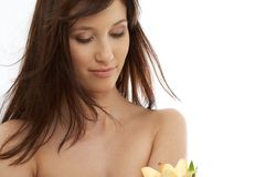 Happy brunette with yellow lily flowers Royalty Free Stock Images
