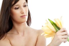 Happy brunette with yellow lily flowers #2 Stock Photo