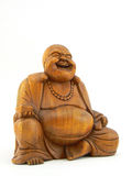Happy Buddha. Happy smiling Buddha figurine carved in wood Royalty Free Stock Photos