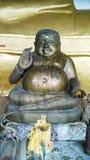 Happy Buddha. Brass Happy Buddha in a temple, Saraburi royalty free stock photo
