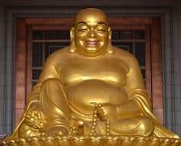 Happy Buddha. Happy Golden buddha sitting cross-legged royalty free stock images