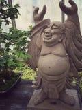 Happy Buddha. A happy Buddha statue in a botanical garden stock photo