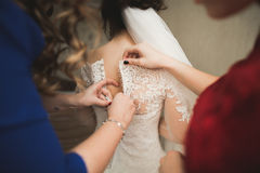 Happy buddies helps bride getting ready for her wedding day in the morning Stock Images