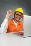 Happy builder with computer. Stock Images
