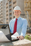 Happy builder in hardhat Royalty Free Stock Photos
