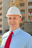 Happy builder in hardhat Stock Images