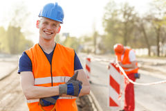 Happy builder in helmet Stock Image