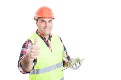 Happy builder holding tablet and showing thumbup Royalty Free Stock Photo