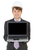 Happy builder shows us laptop screen Royalty Free Stock Photography