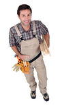 Happy builder with tools. Royalty Free Stock Photography