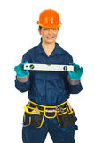 Happy builder woman holding bubble level Stock Photography