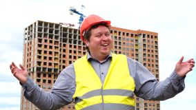 Happy builder worker or architect face expression. Wow, joyful man emotion on construction building site. Surprised smiling man stock video footage