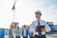 Happy builders and architect at construction site Royalty Free Stock Image