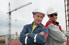 Happy builders at construction site Stock Images