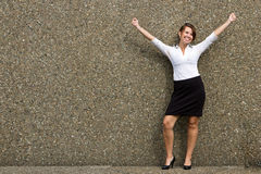 Happy buisness woman with arms up in celebration Stock Photos