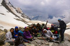 Happy bunch of Trekkers resting and celebrating Himachal Pradesh royalty free stock photography