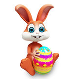 Happy bunny with colourfull egg Stock Image