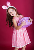 Happy bunny girl is holding gift boxes Stock Photography