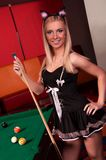 Happy bunny-girl playing in billiard Royalty Free Stock Images